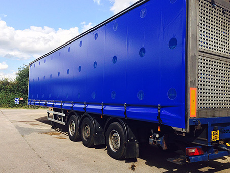 Blue curtainside on large lorry trailer